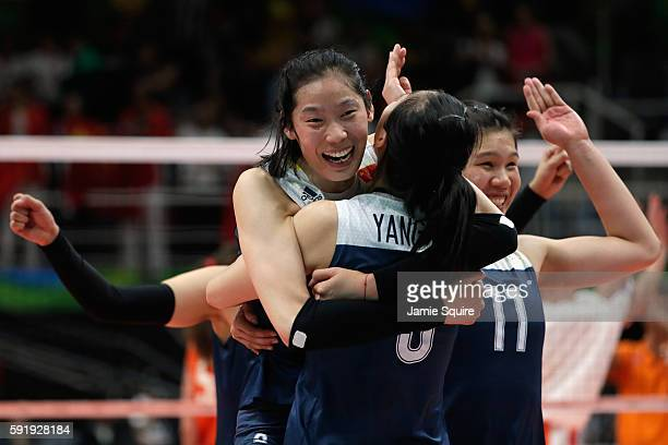Ting Zhu of China celebrates victory over the Netherlands with her teammates in the Women's Volleyball Semifinal match at the Maracanazinho on Day 13...