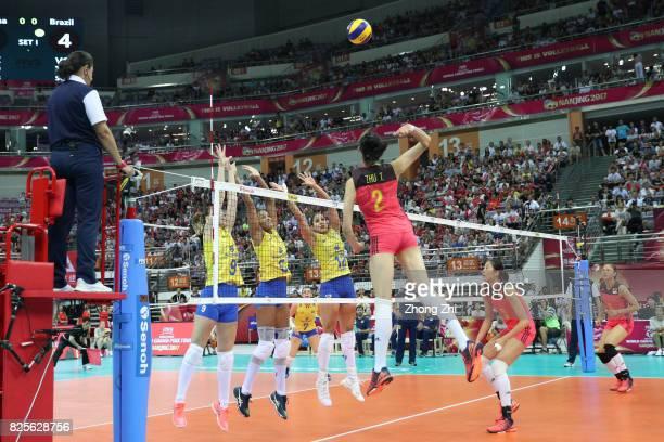 # Ting Zhu of China in action against Edinara Brancher #9 Roberta Silva Ratzke and Natalia Pereira of Brazil during the match between China and...
