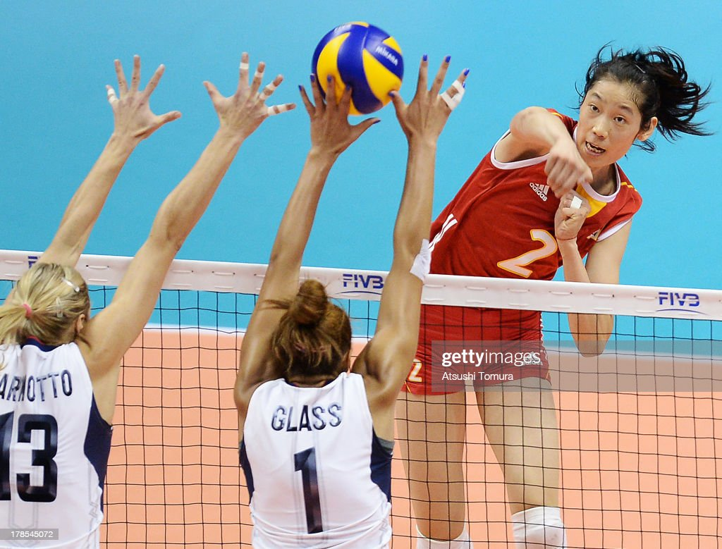 Ting Zhu of China spikes the ball during day three of the FIVB World Grand Prix Sapporo 2013 match between China and USA at Hokkaido Prefectural Sports Center on August 30, 2013 in Sapporo, Hokkaido, Japan.