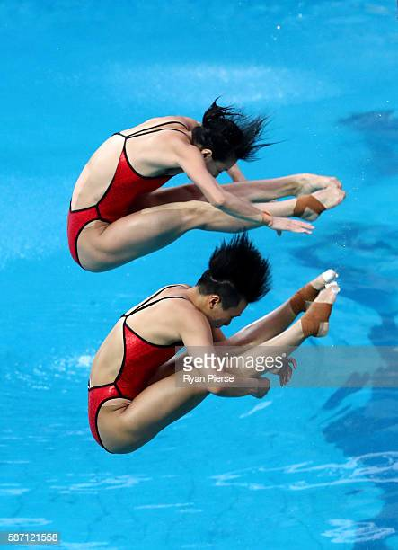 Tingmao Shi and Minxia Wu of China compete in the Women's Diving Synchronised 3m Springboard Final on Day 2 of the Rio 2016 Olympic Games at Maria...