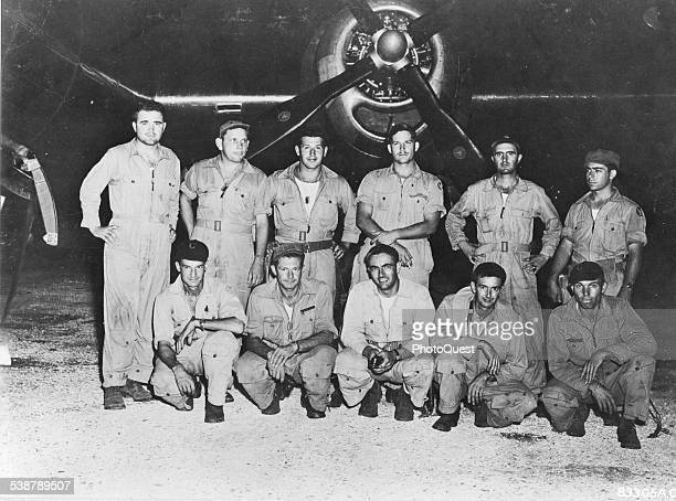 Major Charles W Sweeney and the crew of 'Bock's Car' the B29 that atombombed Nagasaki Japan Tinian Northern Mariana Islands August 9 1945 Kneeling...