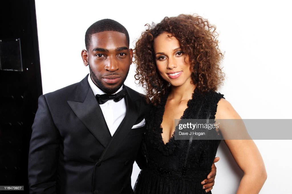 Tinie Tempah and Alicia Keys pose backstage at the Keep a Child Alive Black Ball 2011 at Camden Roundhouse on June 15, 2011 in London, England.