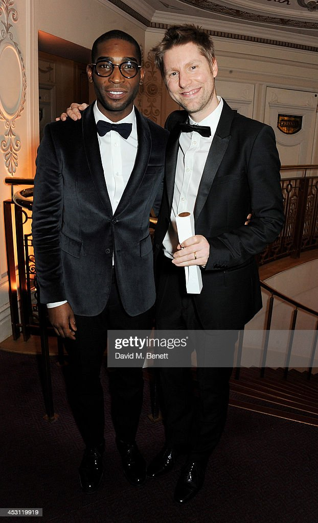 Tinie Tempah (L) and Christopher Bailey, winner of Menswear Designer of the Year, pose at the British Fashion Awards 2013 at London Coliseum on December 2, 2013 in London, England.