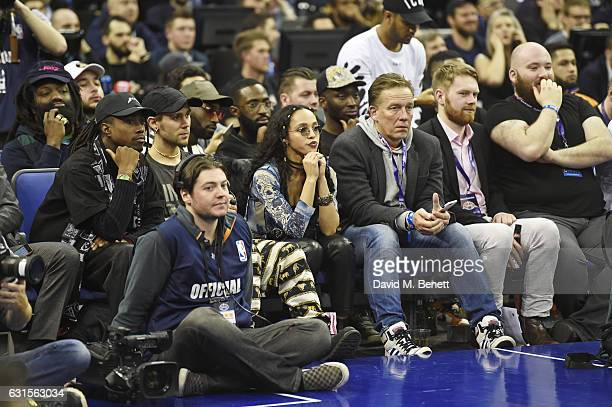 Tinie Tempah and FKA Twigs sit courtside at the NBA Global Game London 2017 basketball game between the Indiana Pacers and Denver Nuggets at The O2...