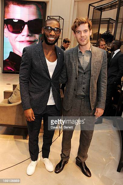 Tinie Tempah and host Harry Treadaway both wearing Burberry attend the Burberry Knightsbridge Menswear store to celebrate London Collections Men AW13...