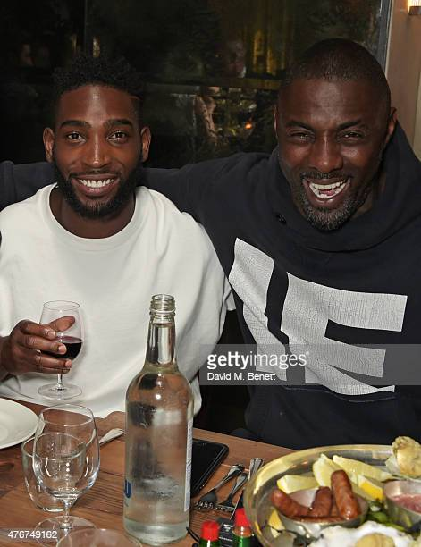 Tinie Tempah and Idris Elba attend the official Idris Elba Superdry presentation at LCM at Hix on June 11 2015 in London England