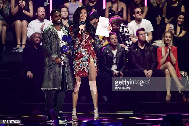 Tinie Tempah and Winnie Harlow present the Best Live award to Twenty One Pilots on stage at the MTV Europe Music Awards 2016 on November 6 2016 in...