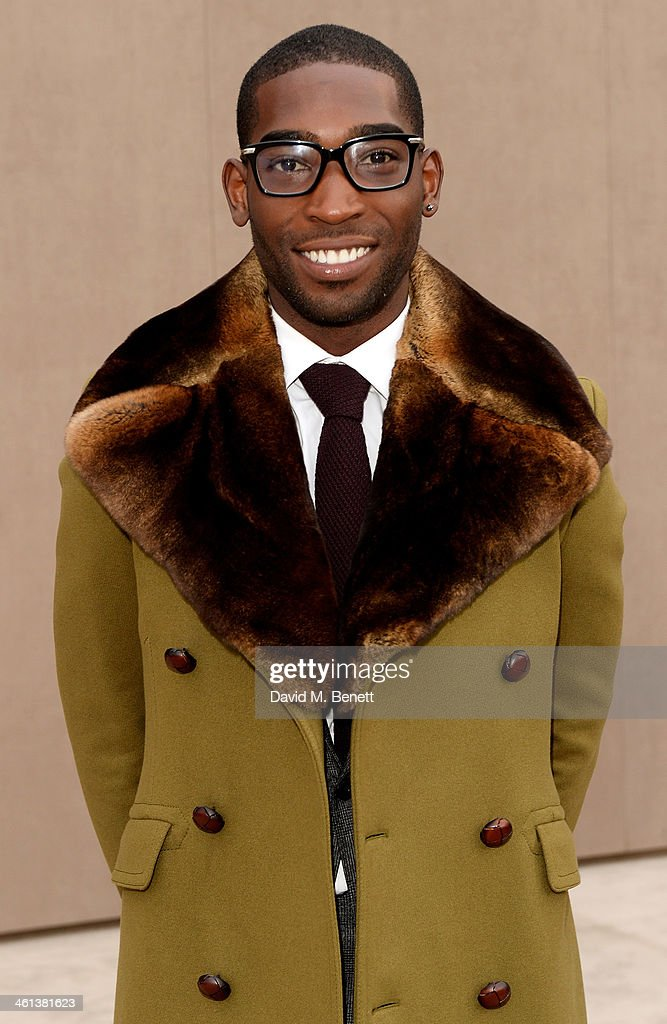Tinie Tempah arrives at the Burberry AW14 Menswear Show at Kensington Gardens on January 8, 2014 in London, England.