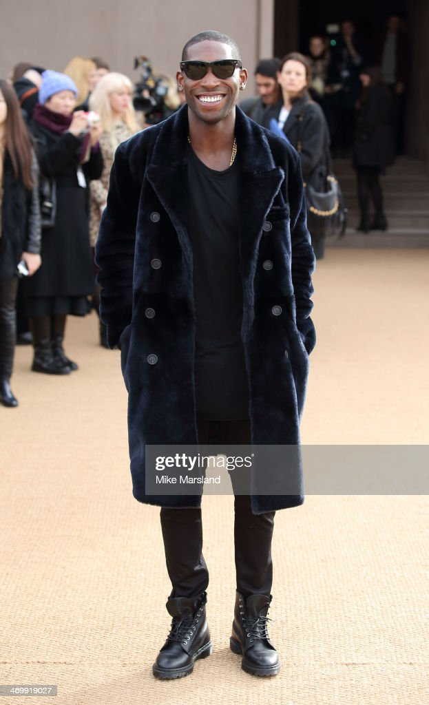 Tinie Tempah attends the Burberry Prorsum show at London Fashion Week AW14 at on February 17, 2014 in London, England.