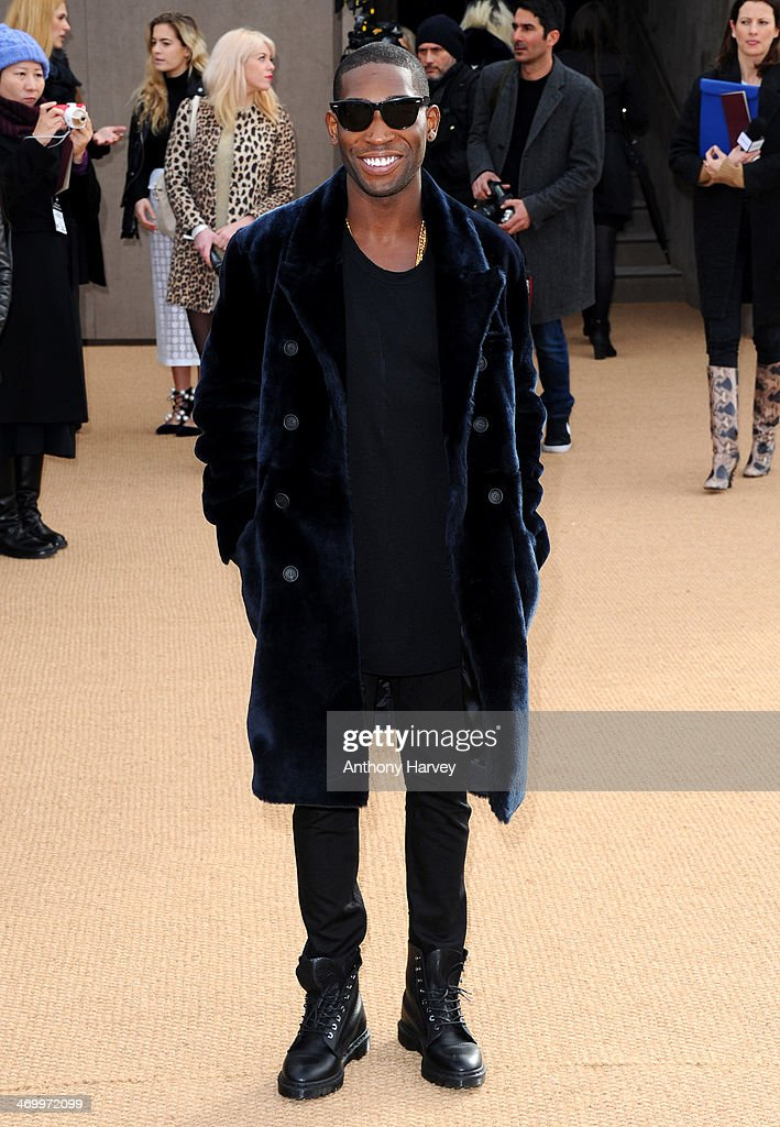 Tinie Tempah attends the Burberry Prorsum show at London Fashion Week AW14 at Kensington Gardens on February 17, 2014 in London, England.
