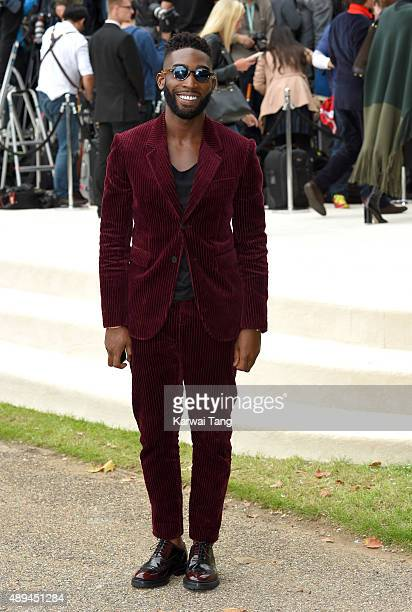 Tinie Tempah attends the Burberry Prorsum show during London Fashion Week Spring/Summer 2016/17 at Kensington Gardens on September 21 2015 in London...