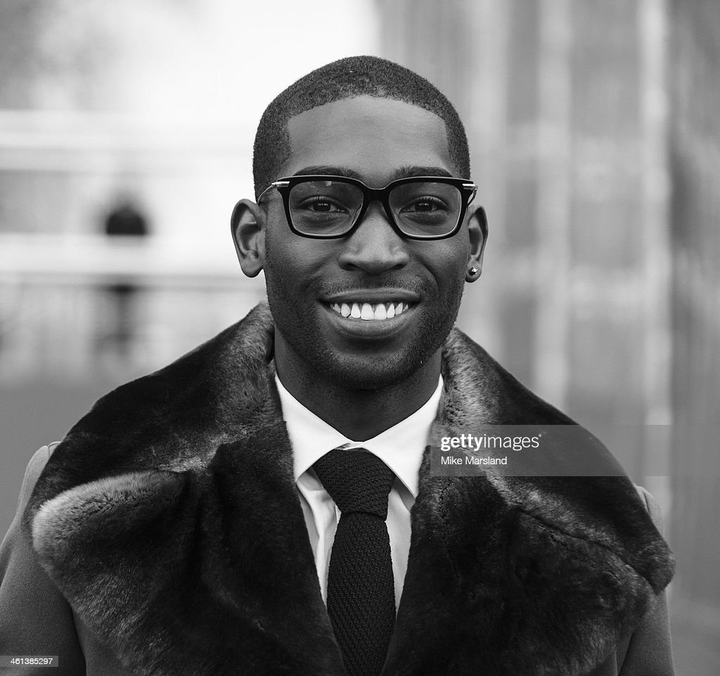 Tinie Tempah attends the Burberry Prorsum show during The London Collections: Men Autumn/Winter 2014 on January 8, 2014 in London, England.