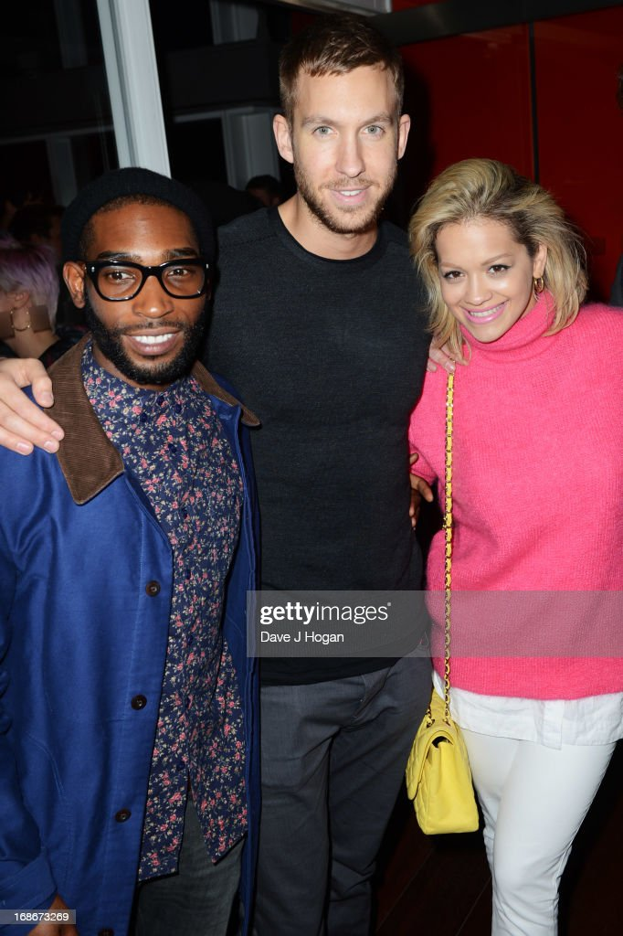 Tinie Tempah, Calvin Harris and Rita Ora attend a listening party for Daft Punk's new album 'Random Access Memories' at The Shard on May 13, 2013 in London, England.