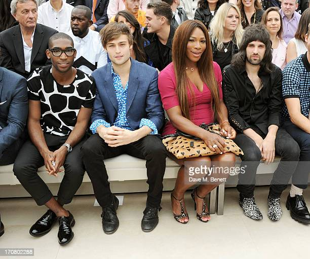 Tinie Tempah Douglas Booth Serena Williams and Sergio Pizzorno sit in the front row at Burberry Menswear Spring/Summer 2014 at Kensington Gardens on...