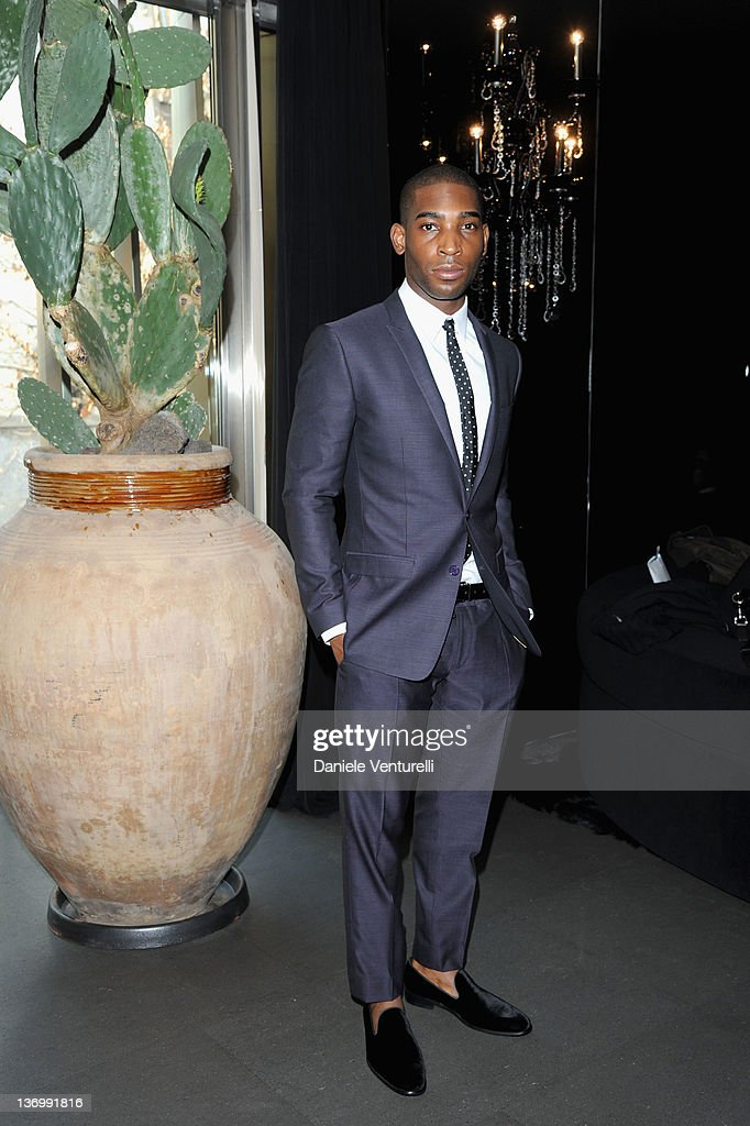 Tinie Tempah poses in the VIP room at the Dolce & Gabbana show as part of the Milan Fashion Week Menswear Autumn/Winter 2012 at Metropol on January 14, 2012 in Milan, Italy.