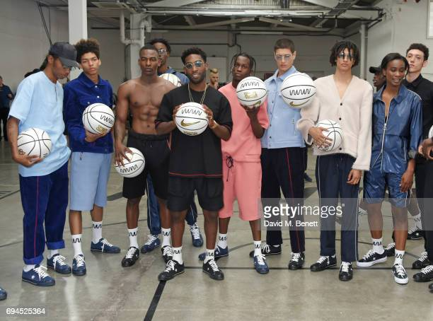 Tinie Tempah poses with models at his What We Wear presentation during London Fashion Week Men's June 2017 at The Old Truman Brewery on June 10 2017...