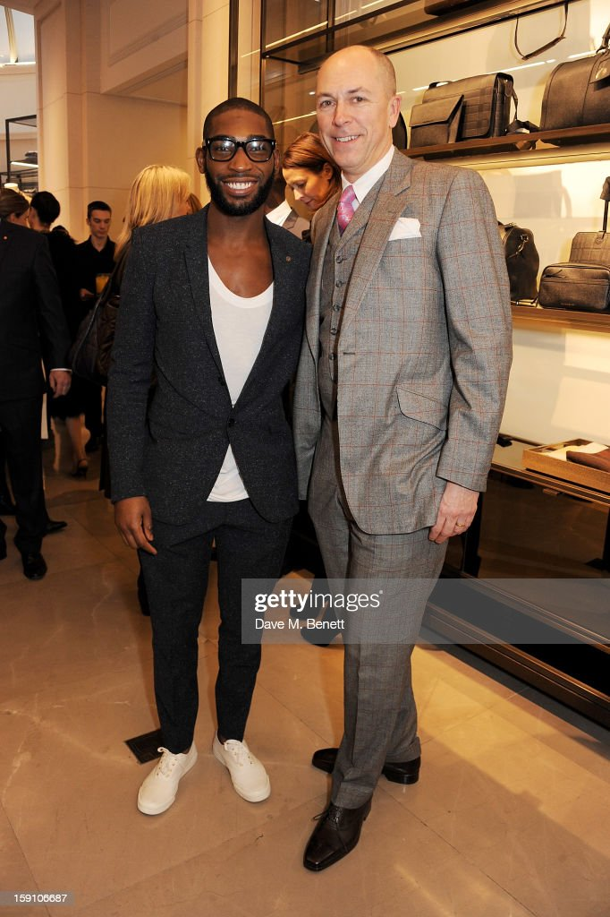 <a gi-track='captionPersonalityLinkClicked' href=/galleries/search?phrase=Tinie+Tempah&family=editorial&specificpeople=6742538 ng-click='$event.stopPropagation()'>Tinie Tempah</a> (L), wearing Burberry, and editor of GQ <a gi-track='captionPersonalityLinkClicked' href=/galleries/search?phrase=Dylan+Jones&family=editorial&specificpeople=712578 ng-click='$event.stopPropagation()'>Dylan Jones</a> attend the Burberry Knightsbridge Menswear store to celebrate London Collections: Men AW13 on January 8, 2013 in London, England.