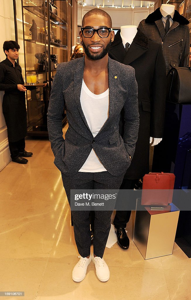 Tinie Tempah, wearing Burberry, attend the Burberry Knightsbridge Menswear store to celebrate London Collections: Men AW13 on January 8, 2013 in London, England.