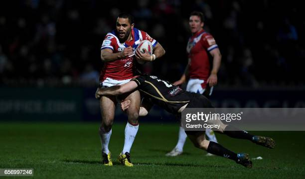 Tinirau Arona of Wakefield is tackled by Ben Reynolds of Leighbduring the Betfred Super League match between Wakefield Trinity and Leigh Centurions...