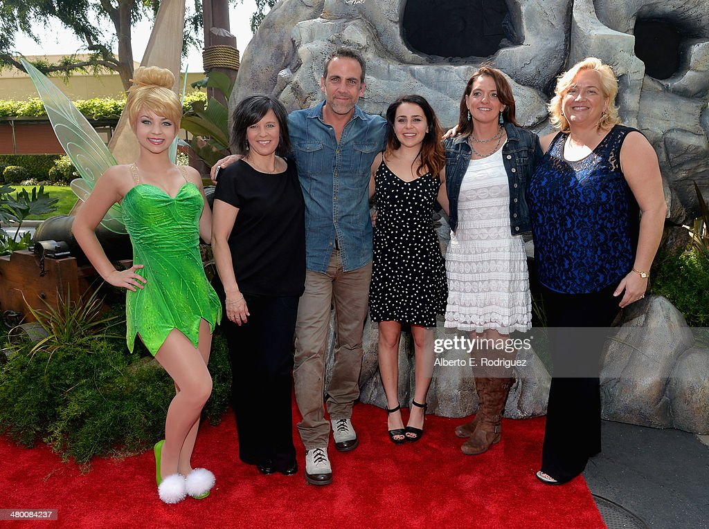 Tinker Bell, director Peggy Holmes , voice actors <a gi-track='captionPersonalityLinkClicked' href=/galleries/search?phrase=Carlos+Ponce&family=editorial&specificpeople=215458 ng-click='$event.stopPropagation()'>Carlos Ponce</a> and <a gi-track='captionPersonalityLinkClicked' href=/galleries/search?phrase=Mae+Whitman&family=editorial&specificpeople=614218 ng-click='$event.stopPropagation()'>Mae Whitman</a>, producer Jenni Magee Cook and Senior Vice President of DisneyToon Studios Meredith Roberts attend Disney's 'The Pirate Fairy' World Premiere at Walt Disney Studios on March 22, 2014 in Burbank, California. On Blu-ray and Digital HD April 1.