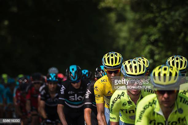 Tinkoff's Spanish cyclist Alberto Contador wearing the yellow jersey of the overall leader rides behind his teammates during the third stage of the...