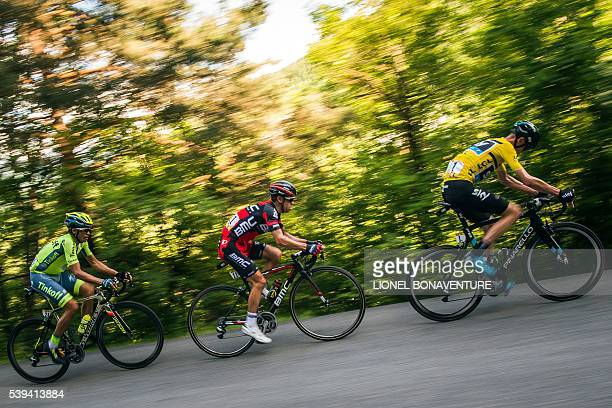 Tinkoff's Spanish rider Alberto Contador BMC's Australian rider Richie Porte and Sky's English rider Christopher Froome ride during the seventh stage...