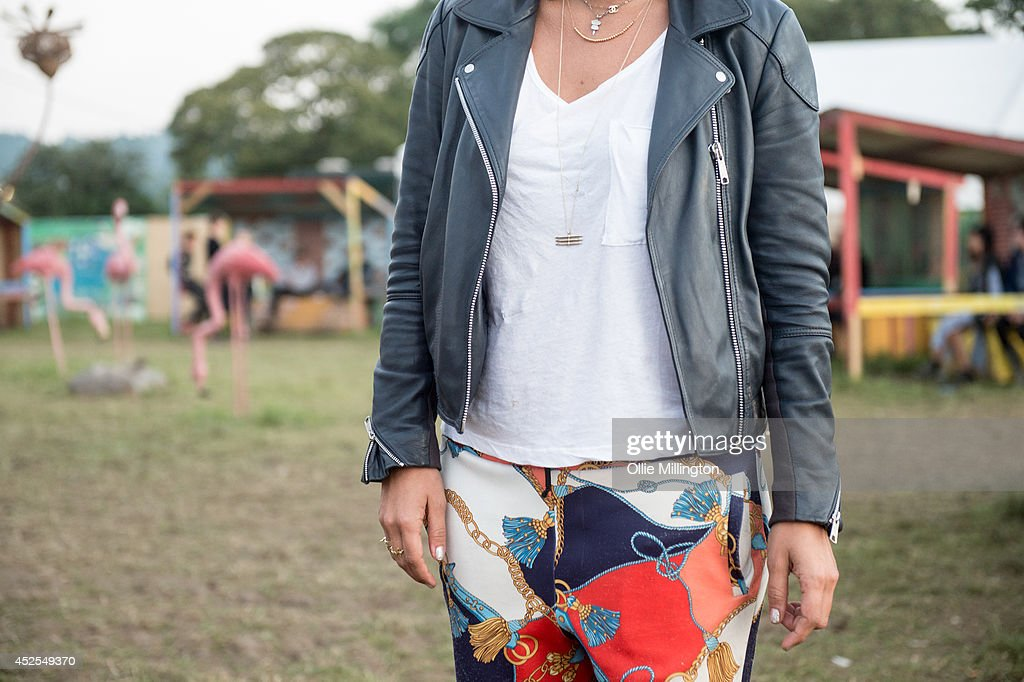 Tinna 24, a designer from Sweden wearing a custom leather jacket with a top from urban outfitters, trousers slef made from curtains and shoes by Supra on the last day of the Glastonbury Festival at Worthy Farm on June 29, 2014 in Glastonbury, England.