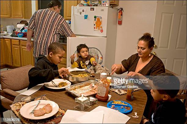 Tinnekkia Williams a victim of domestic violence and a women's advocate shares a meal with her three sons and her brother 'We are losing our children...
