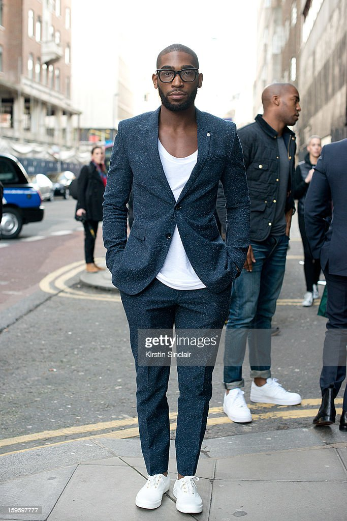 Tinnie Tempah rapper wearing a Burberry suit on day 2 of London Mens Fashion Week Autumn/Winter 2013, on January 08, 2013 in London, England.