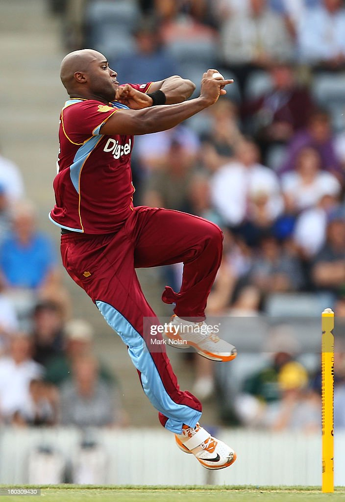 Tino Best of the West Indies bowls during the International Tour Match between the Prime Minister's XI and West Indies at Manuka Oval on January 29, 2013 in Canberra, Australia.