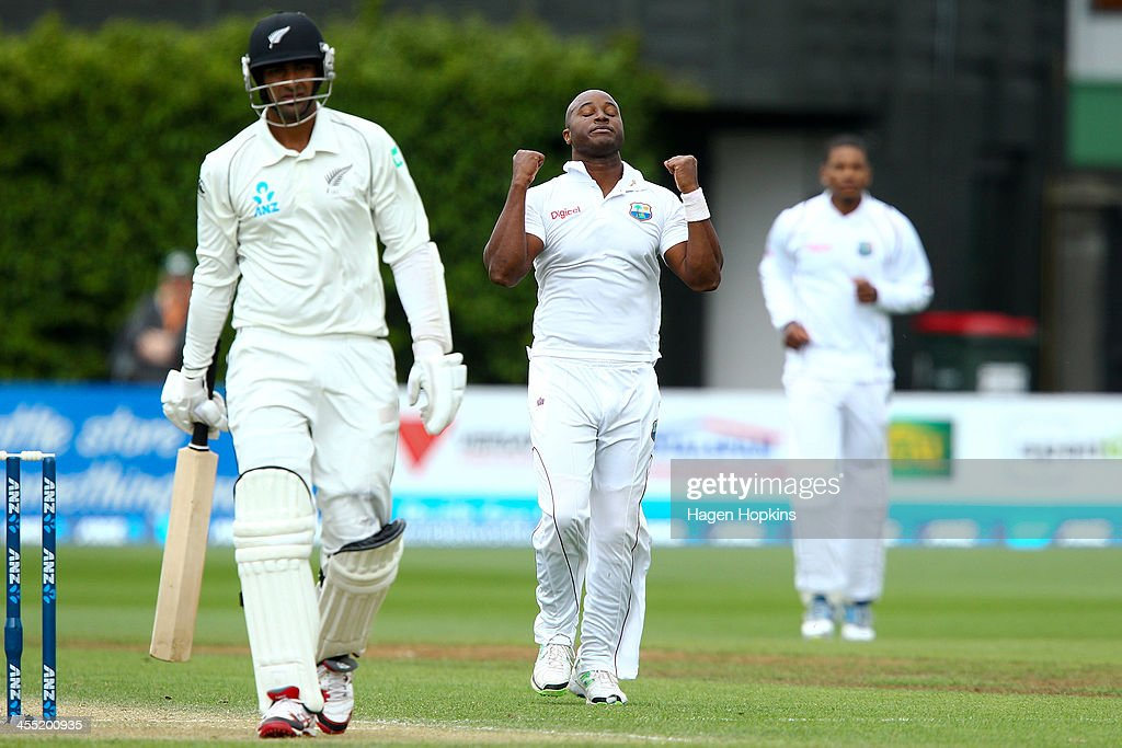 <a gi-track='captionPersonalityLinkClicked' href=/galleries/search?phrase=Tino+Best&family=editorial&specificpeople=209064 ng-click='$event.stopPropagation()'>Tino Best</a> of the West Indies celebrates after taking the wicket of Ish Sodhi of New Zealand during day two of the Second Test match between New Zealand and the West Indies at Basin Reserve on December 12, 2013 in Wellington, New Zealand.