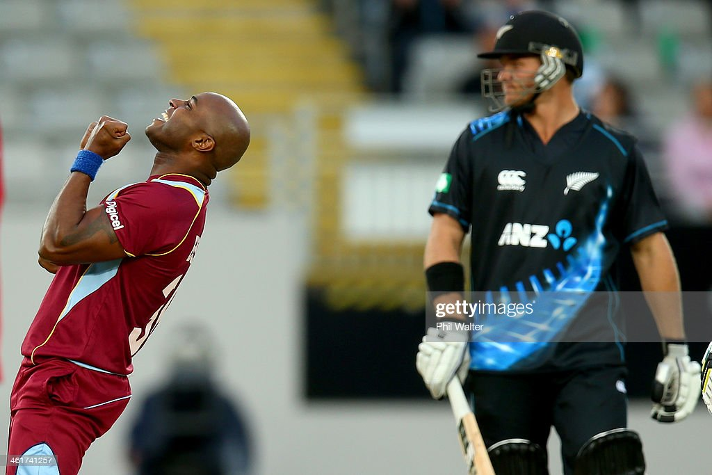 <a gi-track='captionPersonalityLinkClicked' href=/galleries/search?phrase=Tino+Best&family=editorial&specificpeople=209064 ng-click='$event.stopPropagation()'>Tino Best</a> of the West Indies celebrates his wicket of Corey Anderson of New Zealand (R) during the first T20 between New Zealand and the West Indies at Eden Park on January 11, 2014 in Auckland, New Zealand.