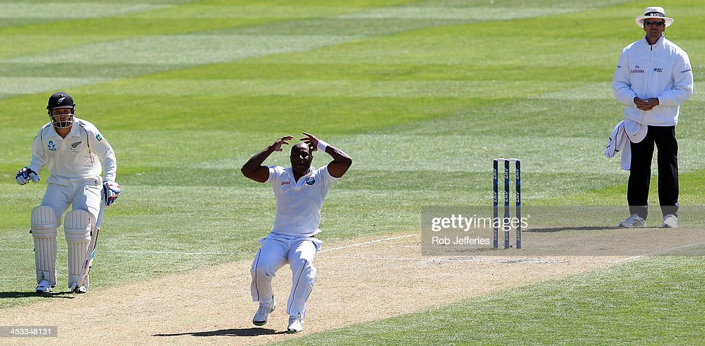<a gi-track='captionPersonalityLinkClicked' href=/galleries/search?phrase=Tino+Best&family=editorial&specificpeople=209064 ng-click='$event.stopPropagation()'>Tino Best</a> of the West Indies reacts after seeing a dropped catch off his bowling during day two of the first test match between New Zealand and the West Indies at University Oval on December 4, 2013 in Dunedin, New Zealand.