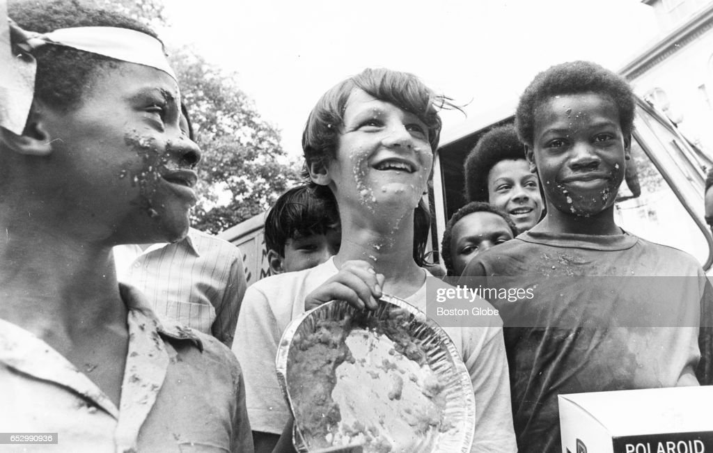 Tino Payne, 2nd place; Shawn Coffey, 3rd place; and Lawrence Payne, 1st place, stand together after the pie eating contest at Summerthing in Boston on Aug. 28, 1972.