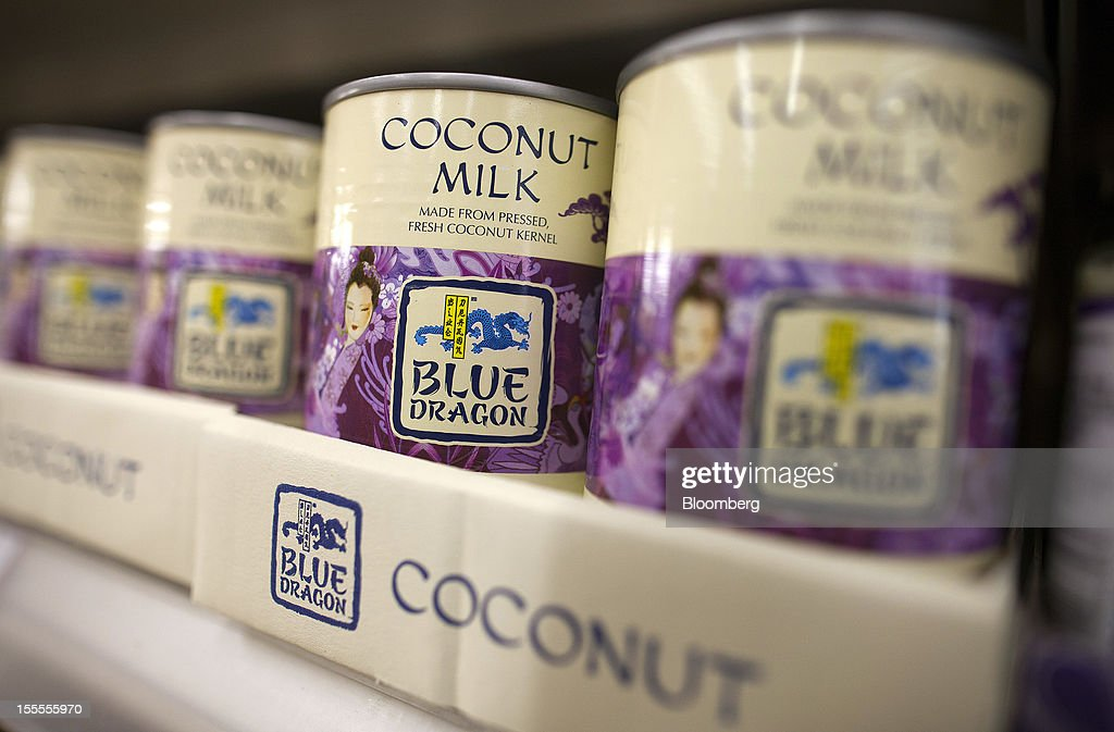 Tins of Blue Dragon coconut milk, produced by Associated British Foods Plc, sit displayed for sale at a supermarket in London, U.K., on Monday, Nov. 5, 2012. AB Foods shares have gained 17 percent this year, fueled by the growth of the sugar unit and Primark, the company's two main profit contributors. Photographer: Simon Dawson/Bloomberg via Getty Images