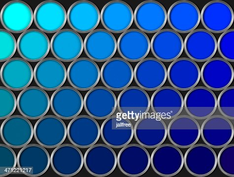Blue Paint tins of blue paint in rows on black background stock photo | getty