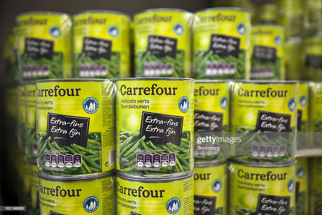 Tins of Carrefour-branded green beans sit on display inside a Carrefour SA supermarket in Portet sur Garonne, near Toulouse, France, on Tuesday, March 5, 2013. Carrefour's stock has risen 47 percent since Georges Plassat's arrival as chief executive officer, partially offsetting a 71 percent decline in the preceding five years. Photographer: Balint Porneczi/Bloomberg via Getty Images