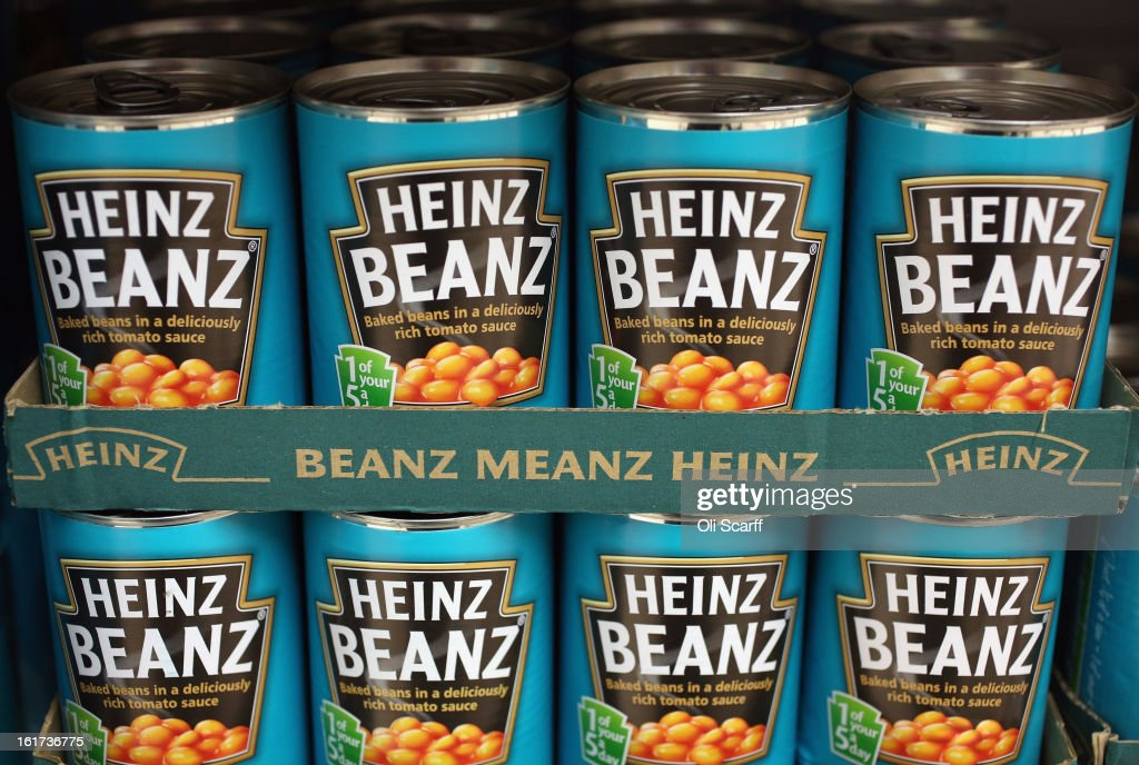 Tins of H.J. Heinz Co. Baked Beanz on February 15, 2013 in London, England. Billionaire investor Warren Buffett's Berkshire Hathaway is is teaming up with the Brazilian investment group 3G Capital to buy H.J. Heinz Co. for 23.3 billion USD.