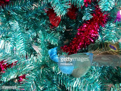 tinsel christmas tree green turquoise peacock decorations glitter red tinsel stock