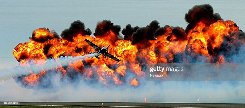 Tinstyx of Dynamite perform a finale to the show during the 2013 Melbourne International Airshow held at Avalon Airport in Geelong, Victoria. The International Airshow will open to the public tomorrow, after the industry got to review new aircraft this week.