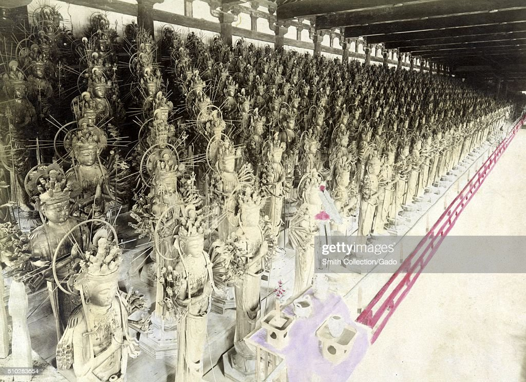 Tinted photograph of a portion of the thousand statues that stand in the Sanjusangendo Temple each statue depicts the main deity of the temple known...