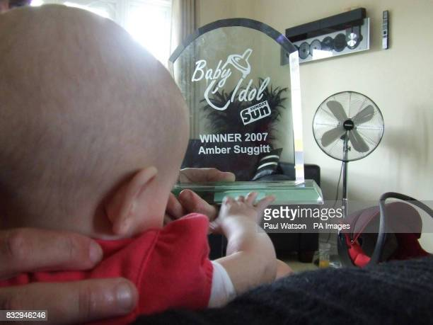 Tiny Amber Suggitt looks towards her success in a 'Bonny Baby' style competition in a local newspaper despite readers not knowing of her past traumas...