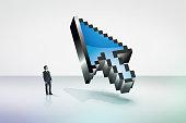Tiny businessman looking at a giant 3D cursor