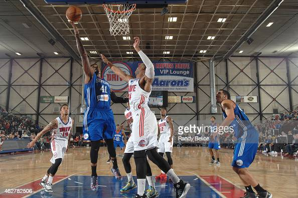 Tiny Gallon of the Delaware 87ers goes to the basket over Renaldo Woolridge of the Grand Rapids Drive during the NBA DLeague game on January 31 2015...