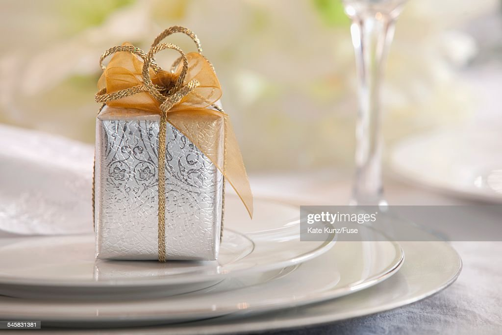 Tiny gift on plate : Stock Photo