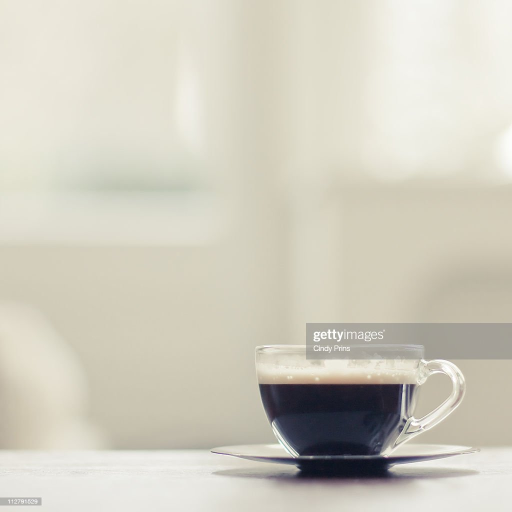 Tiny glass cup of espresso coffee : Stock Photo