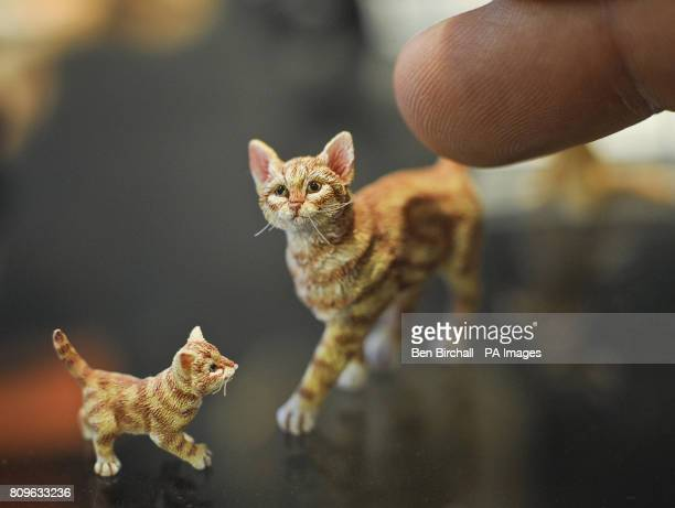 Tiny hairs cover the coats of these 1/12th scale cat and kitten made by Sarah Hendry at the Karon Cunningham Miniatures shop in Bath
