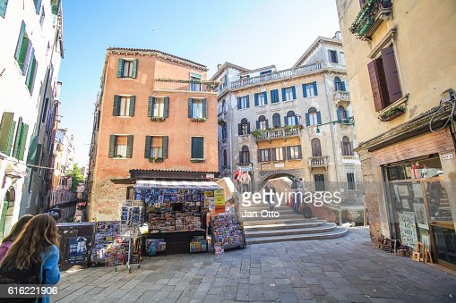 Tiny houses and bridge over a canal in Venice, Italy : Stock Photo