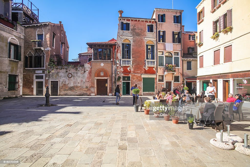 Tiny houses and small square in Venice, Italy : Stock Photo