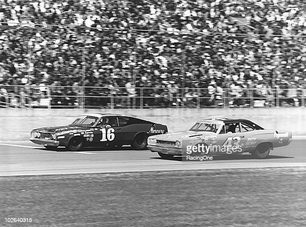 Tiny Lund leads Richard Petty during the Daytona 500 at Daytona International Speedway Petty finished eighth and Lund was ninth in the race Note the...